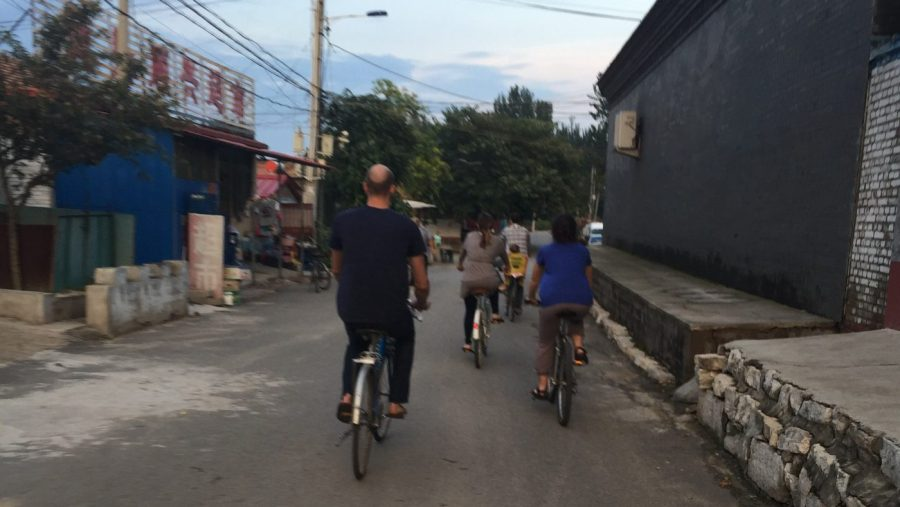 people riding bikes in Chinese village